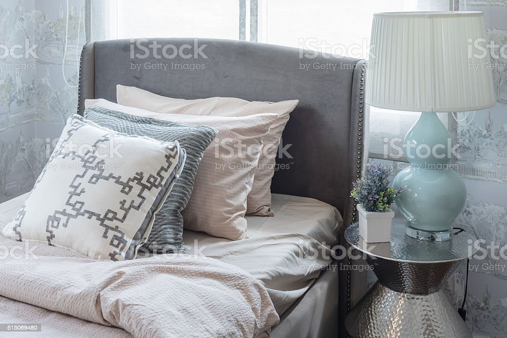 row of pillows on bed in luxury bedroom stock photo