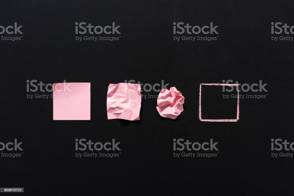 row of pink blank notes in different states isolated on black stock photo
