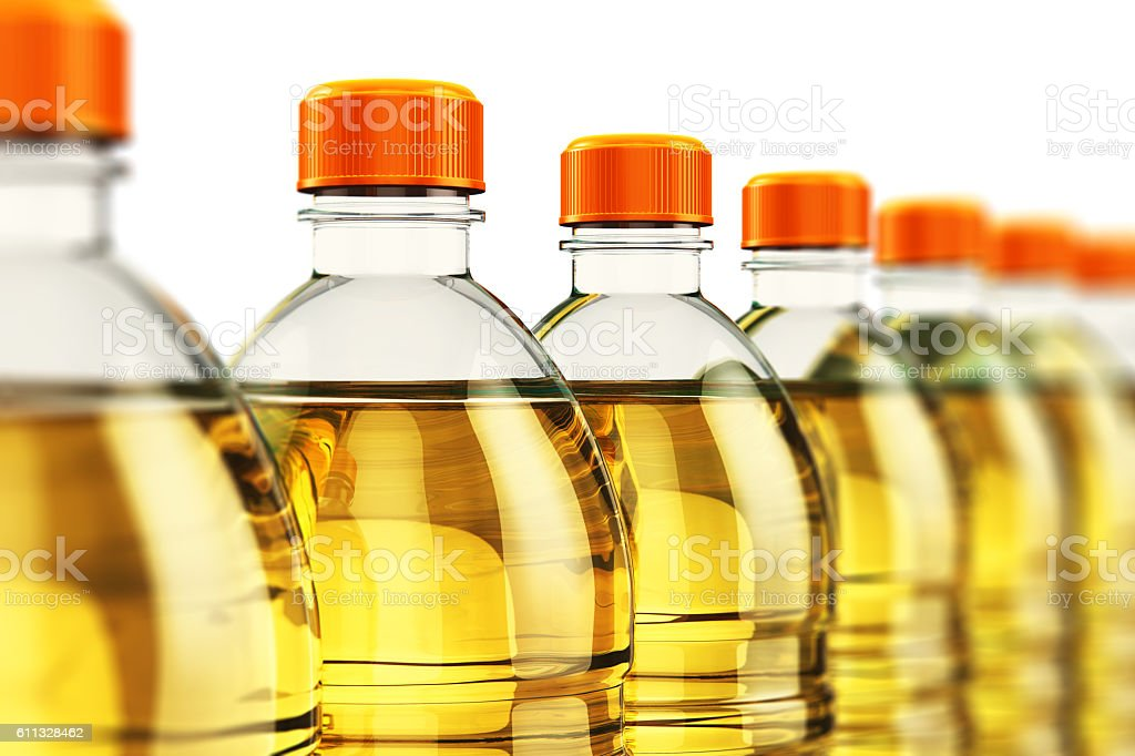 Row of plastic bottles with vegetable cooking oil stock photo