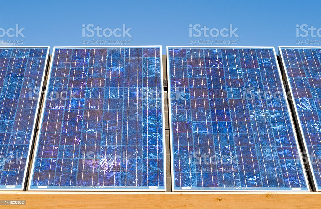 Row of Polycrystalline Photovoltaic PV Solar Panels royalty-free stock photo
