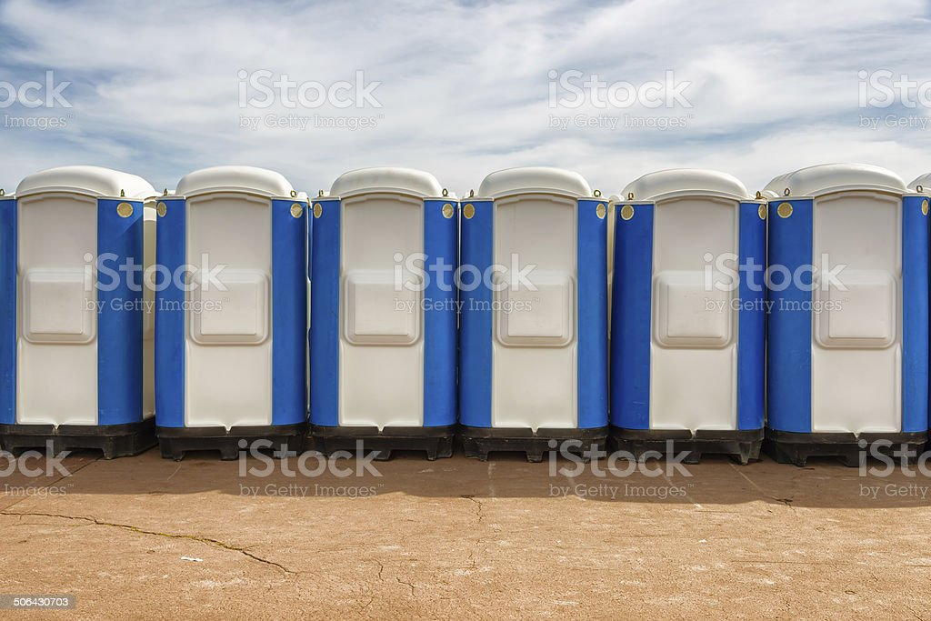 row of portable public wc in the street stock photo
