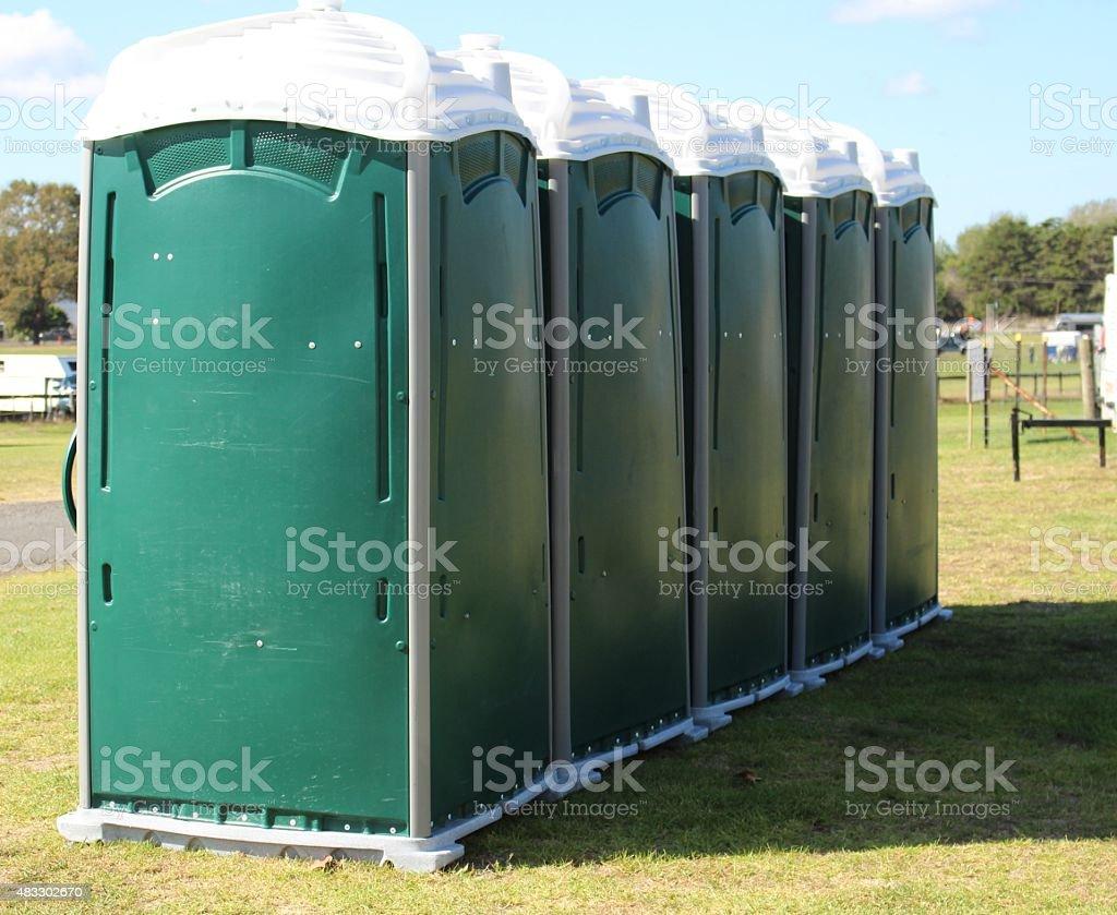 Row of portable toilets stock photo