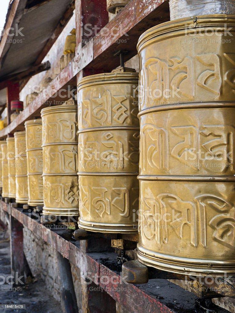 Row of Prayer wheels royalty-free stock photo