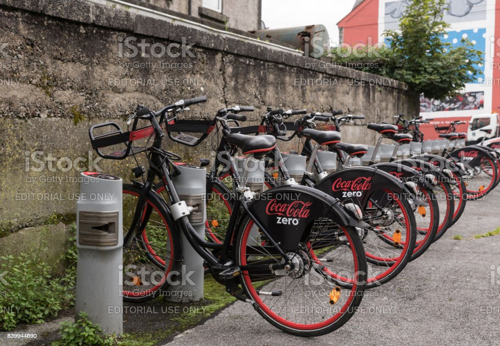 Row of public bikes for rent in Galway, Ireland. stock photo