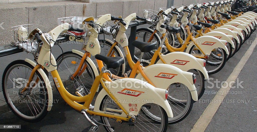 Row Of Public Rental Bicycles In Milan Italy Europe stock photo