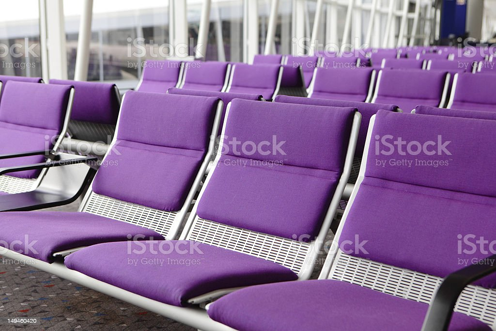 row of purple chair at airport royalty-free stock photo