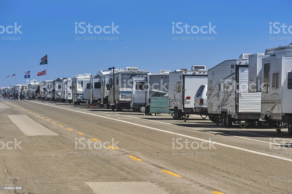 Row of recreational vehicles parked on road stock photo