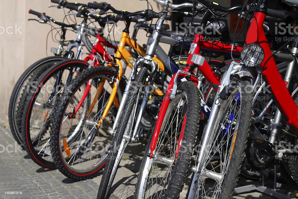 Row of red and yellow bicycles in a shop stock photo