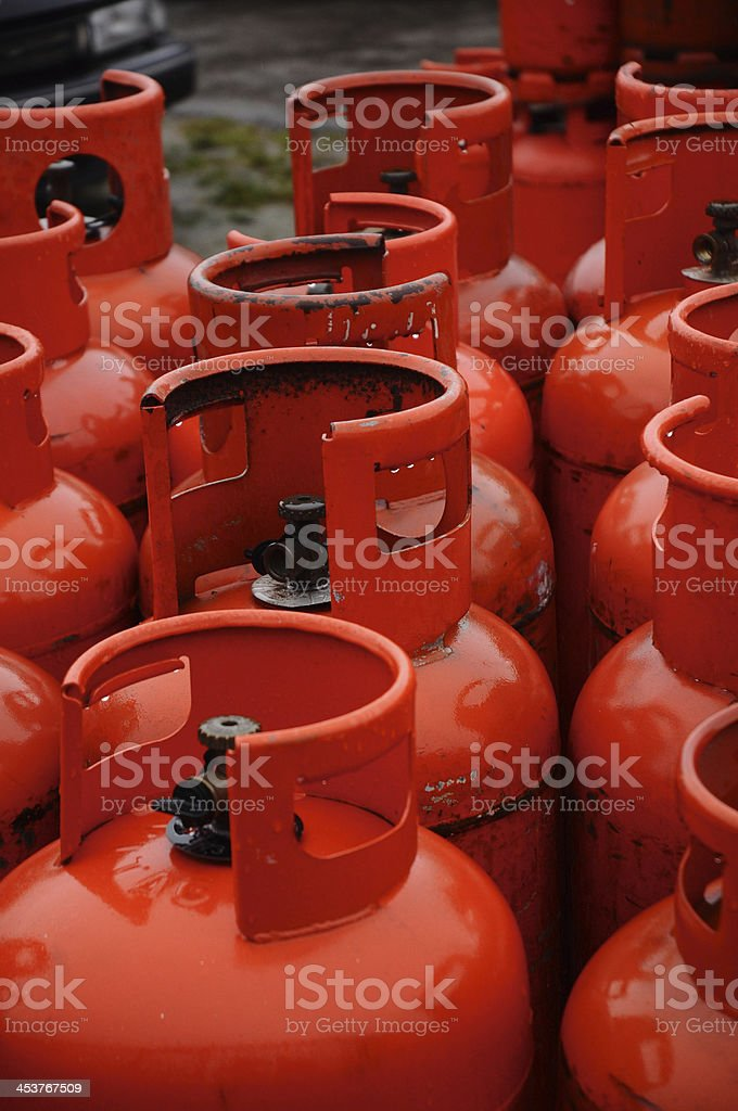 Row of red gas canisters stock photo