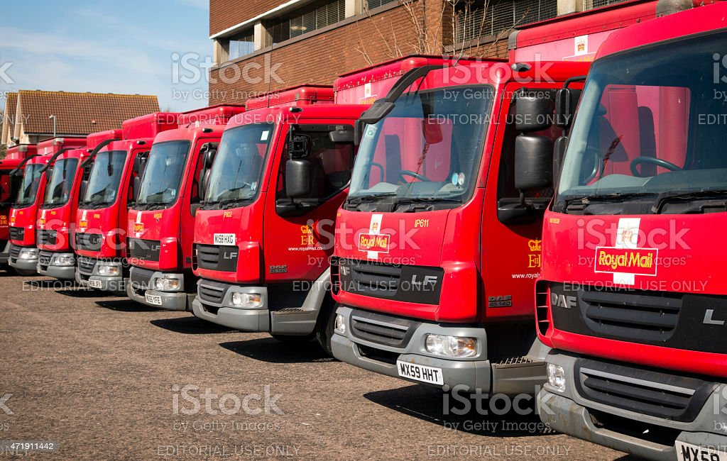Row of red Royal Mail vans stock photo