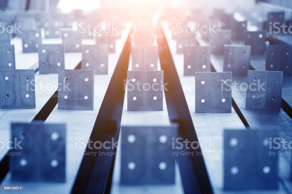 Row of rolls of aluminum lie in production shop of plant. stock photo