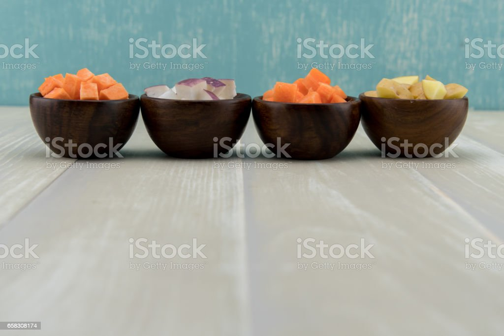 Row of Root Vegetables in Wooden Bowls stock photo