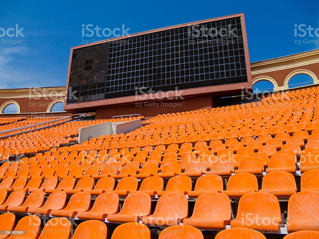 row of seats and score board stock photo