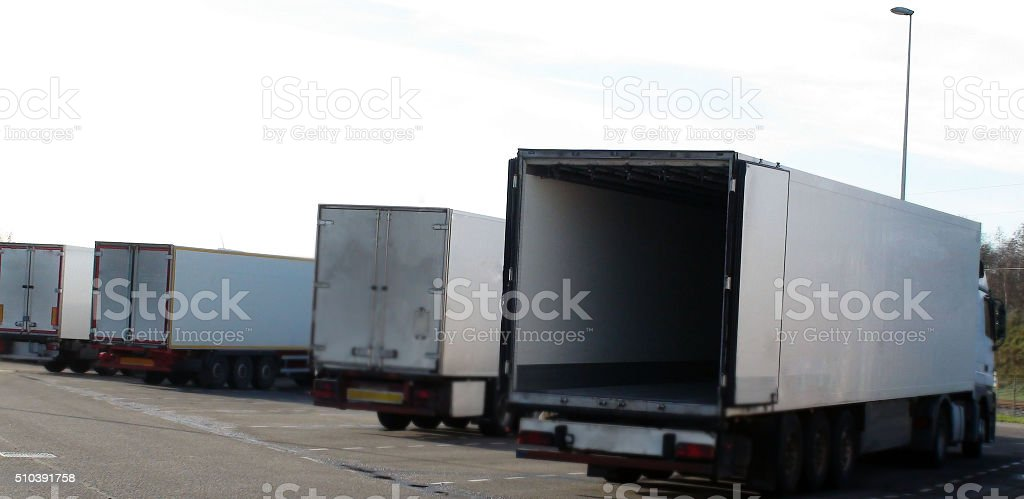 Row Of Semi Truck Parked Close To The Road stock photo