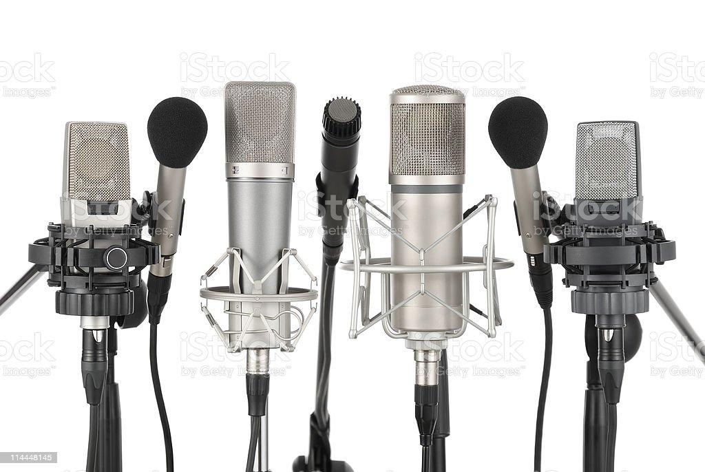 Row of seven microphones stock photo