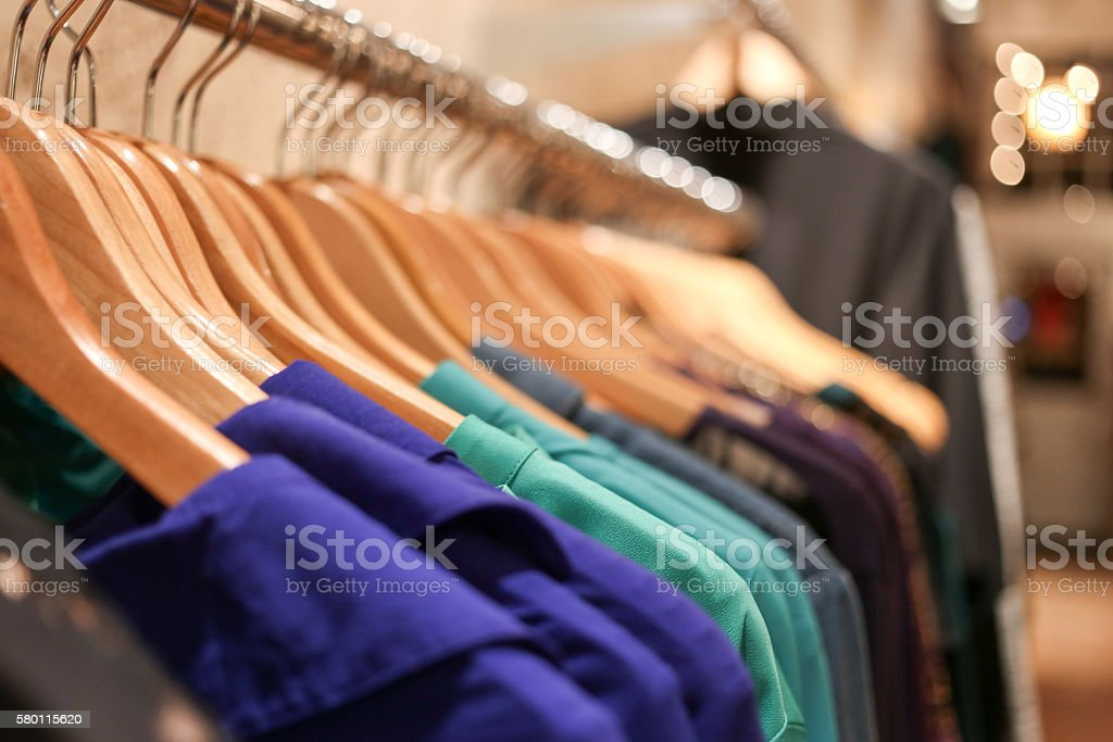 Row of shirts hanging on rack stock photo