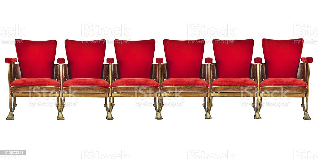 Row of six vintage cinema chairs isolated on white stock photo