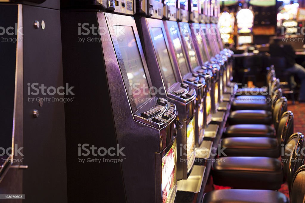 Row of  slot machines in a casino stock photo