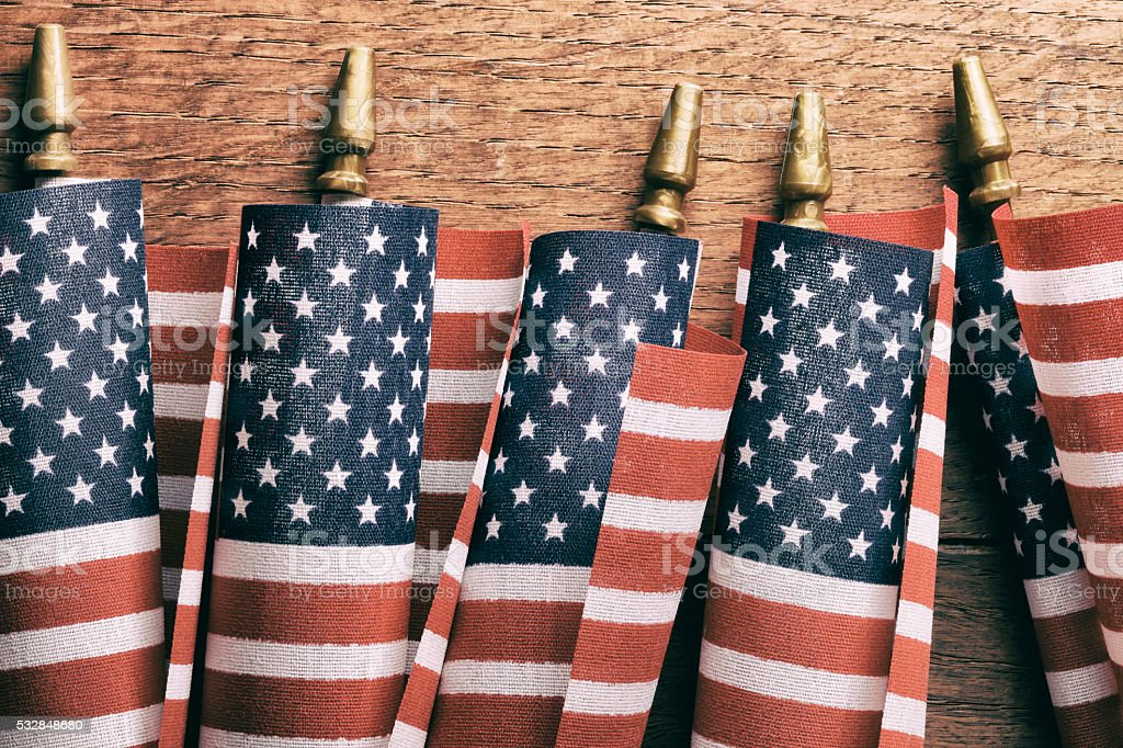 Row Of Small Curled American Flags stock photo