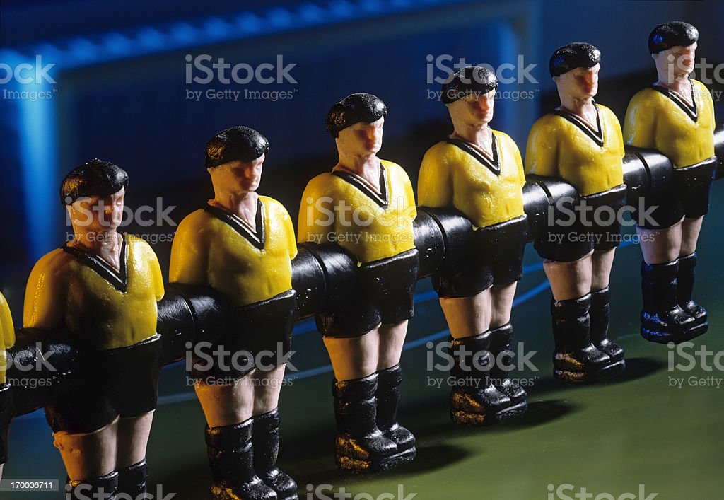 Row of soccer toy players stock photo