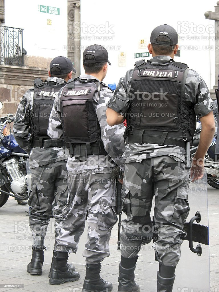 Row of South American riot police confronting demonstrators royalty-free stock photo