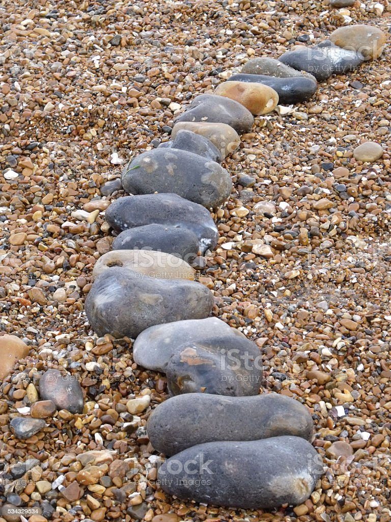 Row of stones on a beach stock photo