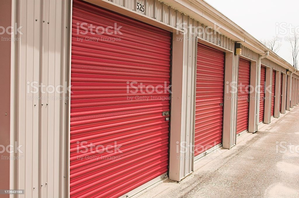 A row of storage units with red doors stock photo