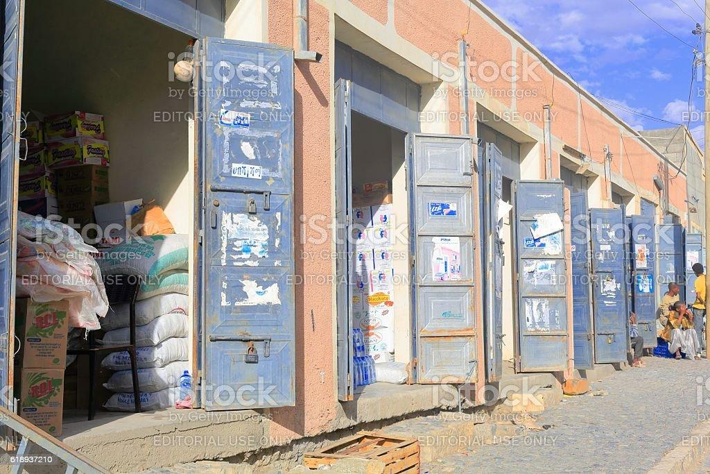 Row of storefronts aligned on a street, Mekelle-Ethiopia. 0452 stock photo