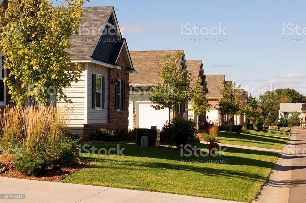 Row of suburban houses on a sunny day stock photo