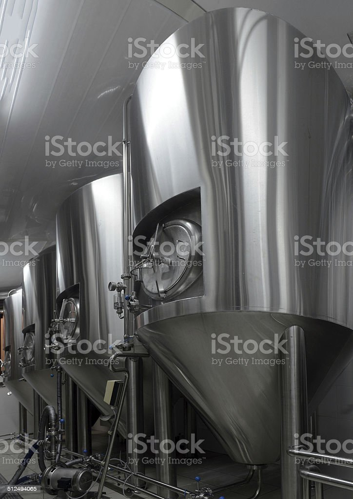 Row of tanks in microbrewery stock photo