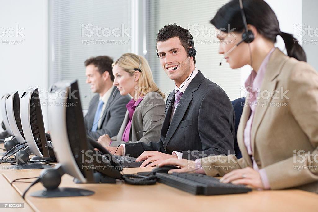 Row of telephonists stock photo
