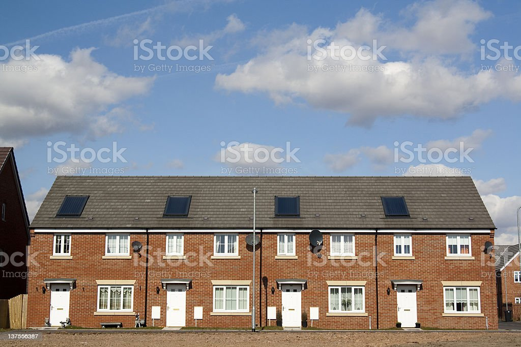 Row of terraced houses with white doors royalty-free stock photo