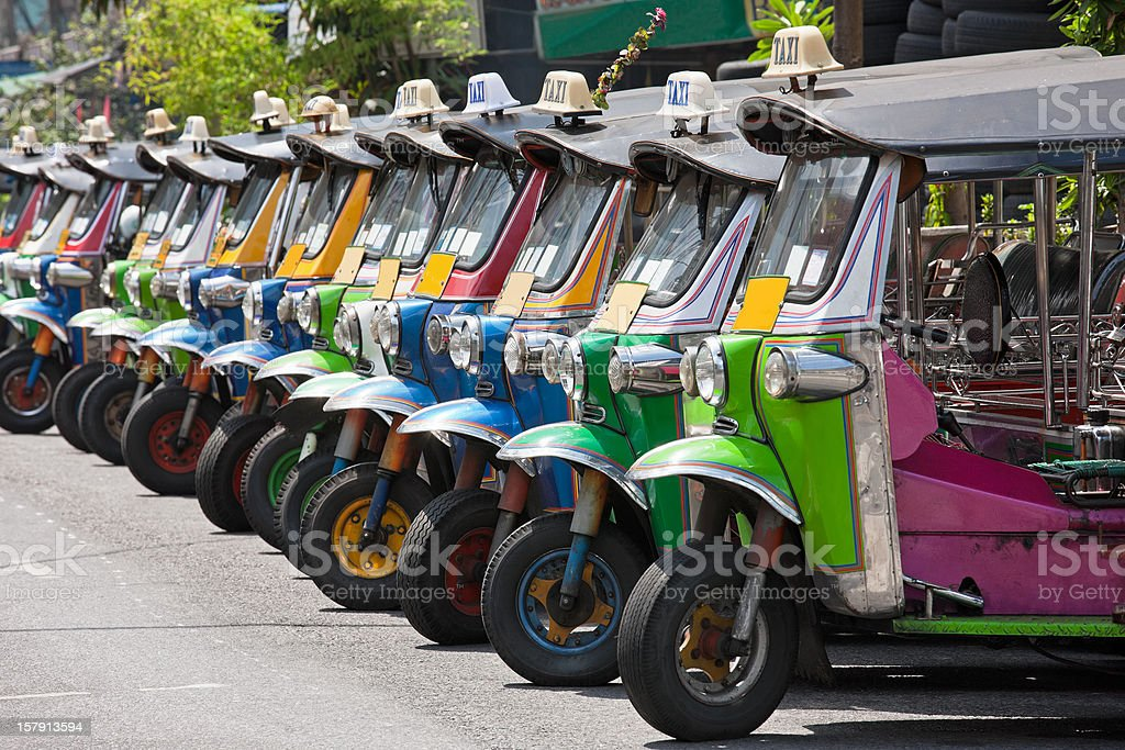Row of Thai Tuk-tuks. stock photo