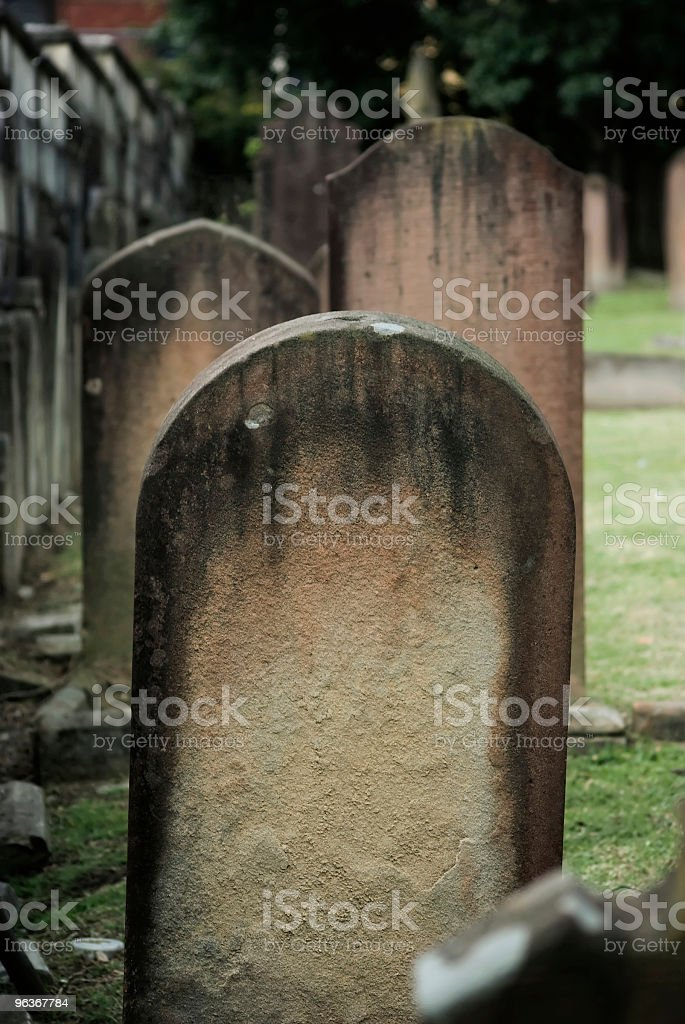 Row of three grave stones in old churchyard cemetery stock photo