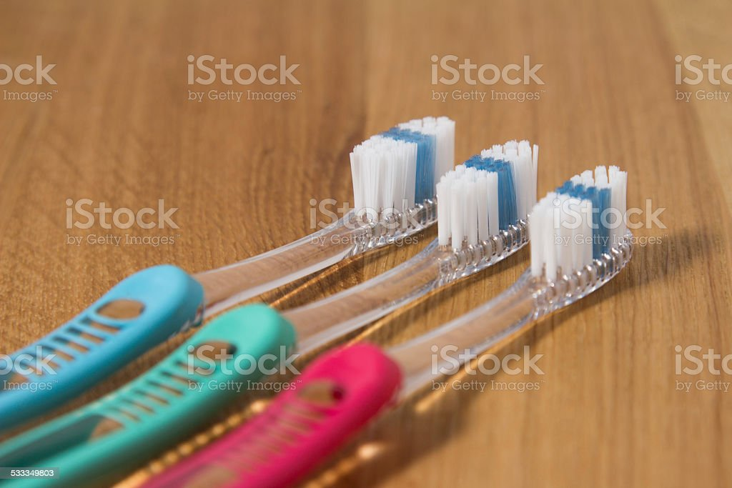 Row of three new tooth brushes stock photo