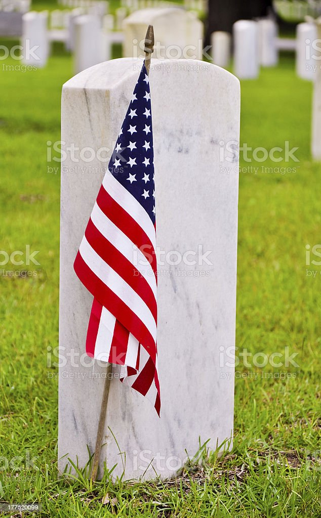 row of tombstones with american flag stock photo