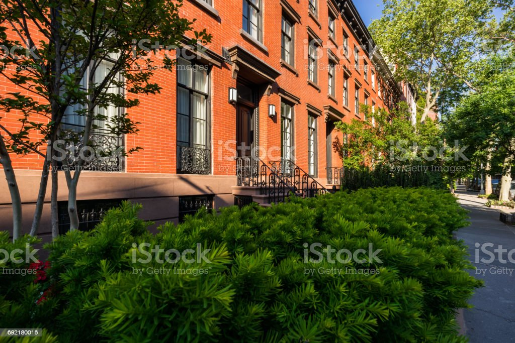 Row of townhouses with brick facades in Summer. Chelsea. Manhattan, New York City stock photo
