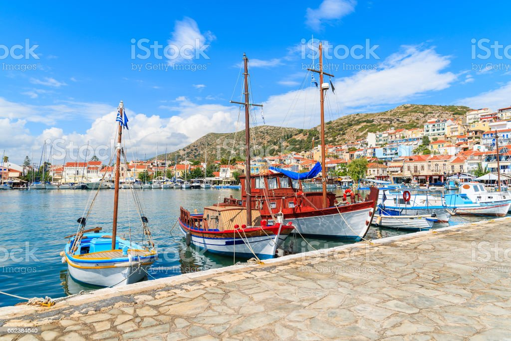 Row of traditional colourful Greek fishing boats in Pythagorion port, Samos island, Greece stock photo