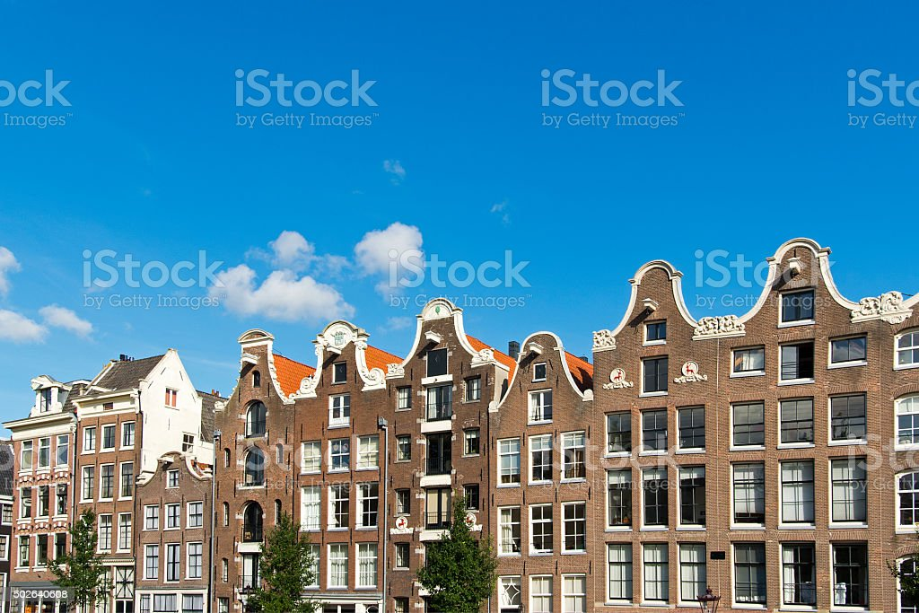 Row of traditional dutch canal houses in Amsterdam stock photo