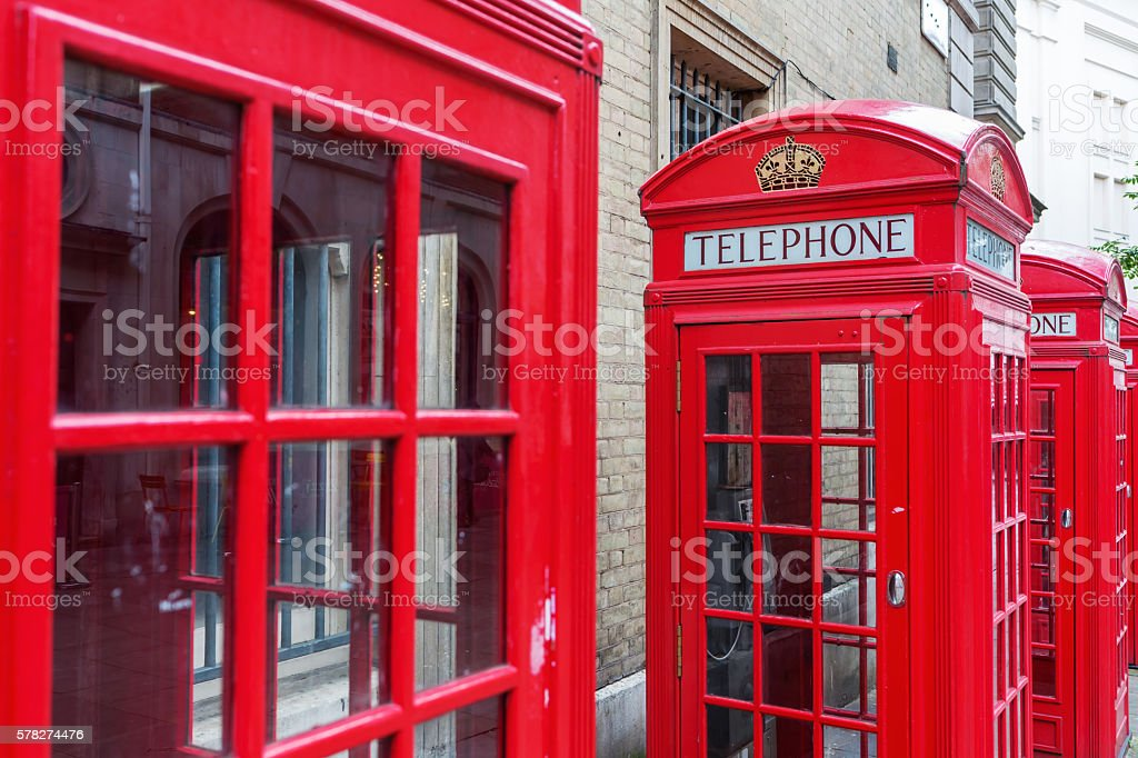 row of traditional red phone boxes in London, UK stock photo