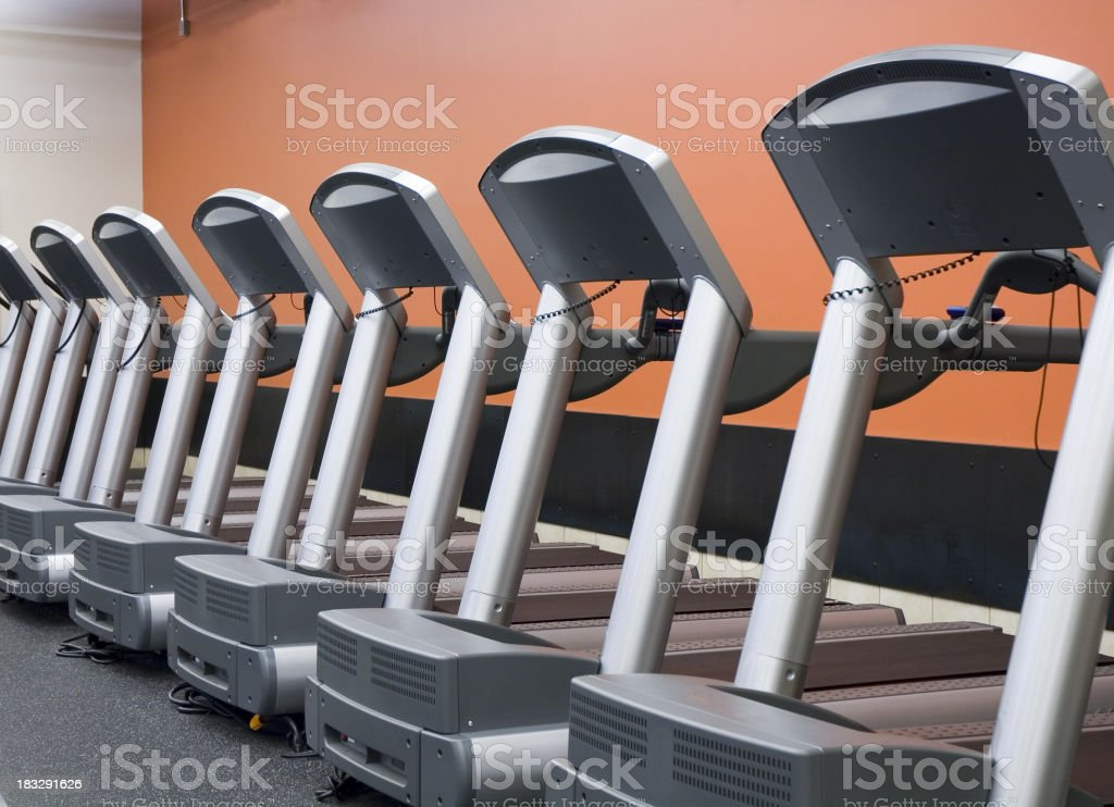 Row of treadmills in a health club royalty-free stock photo