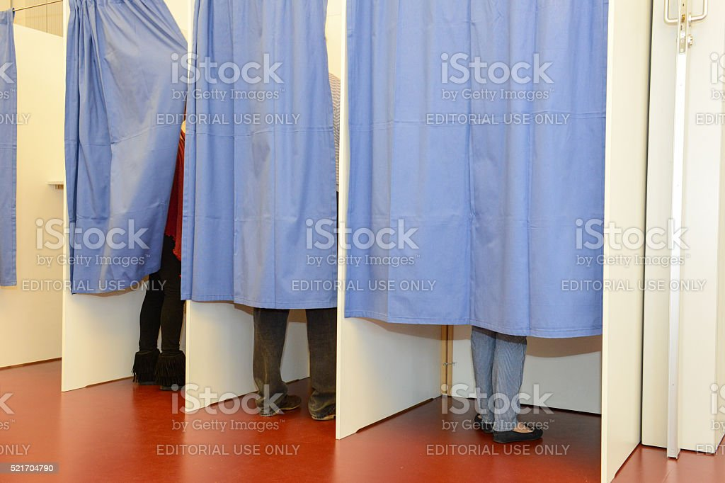 Row of tree voting booths stock photo