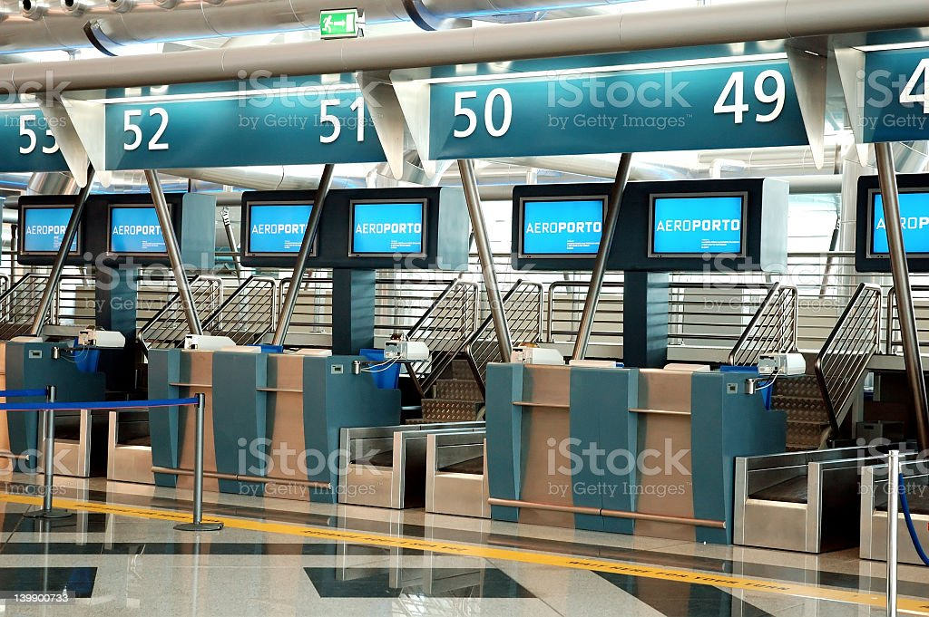 Row of unmanned check-in desks at the airport stock photo