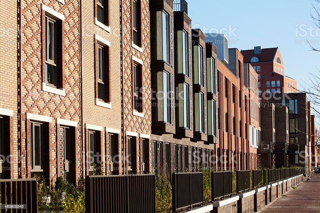 Row of urban townhouses and sidewalk stock photo