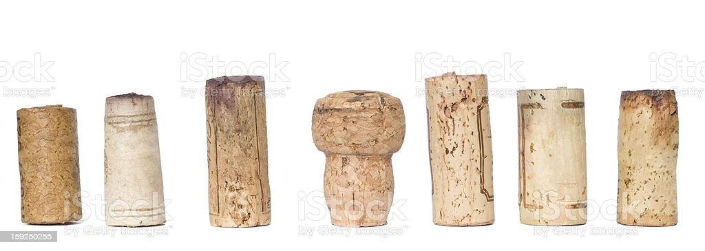Row of various wine corks isolated on white stock photo