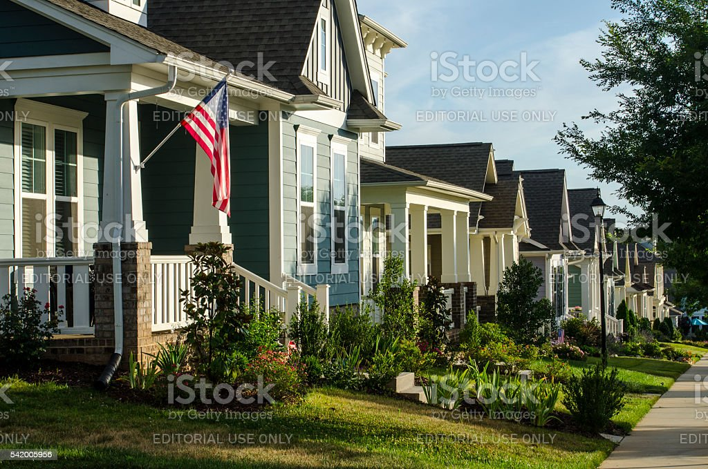 Row of Victorian-Style Homes in a New Neighborhood stock photo
