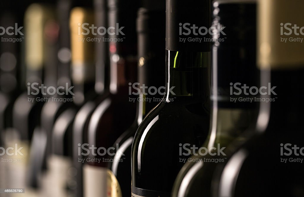 Row of vintage wine bottles in a wine cellar, vinery background