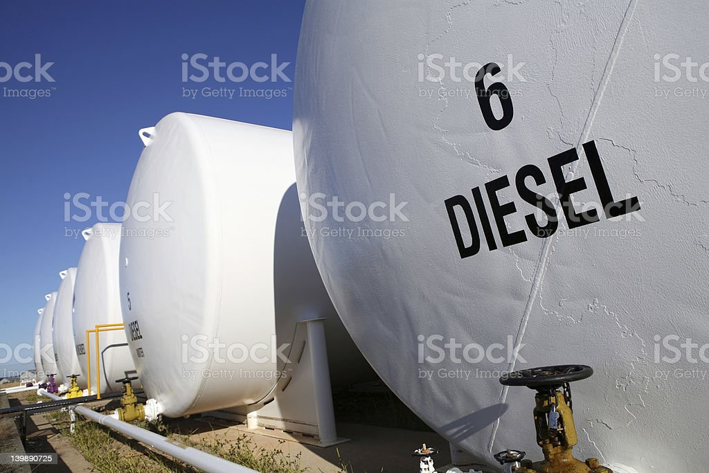 Row of white fuel tanks outdoors stock photo