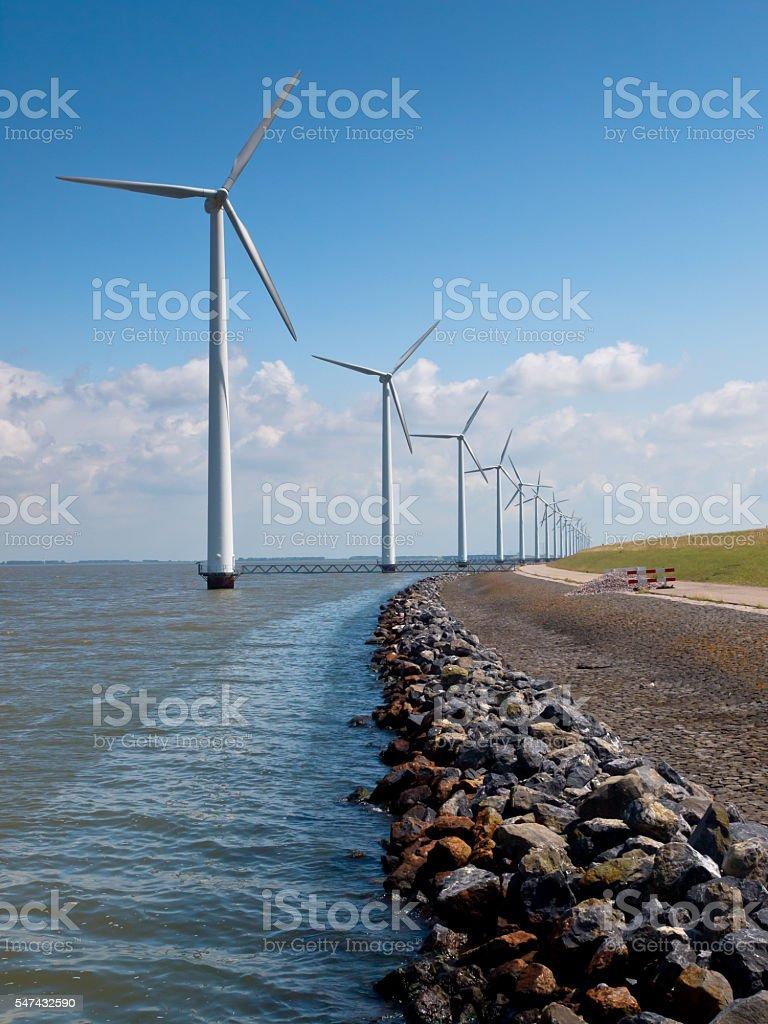 Row of wind turbines along the coast stock photo