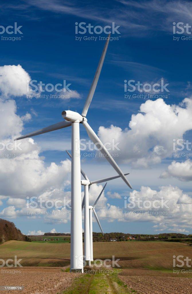 Row of wind turbines. Blue sky. royalty-free stock photo